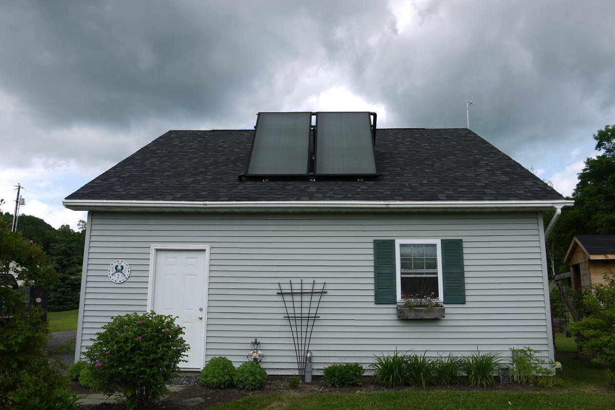 Photo of a home with solar hot water panels